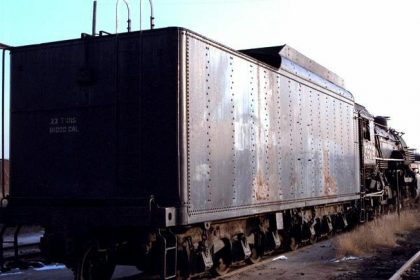 Image of an old, rusted railcar still on the railroad tracks. Railroad workers exposed to asbestos dust may be entitled to compensation.