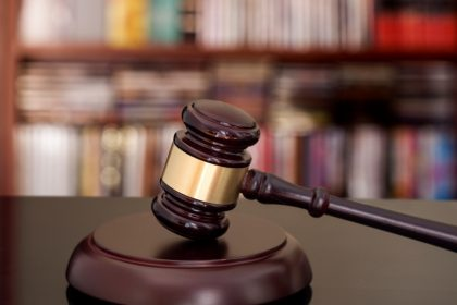 Image of a gavel, representing a supreme court ruling that railroad workers exposed to asbestos dust may be entitled to compensation.