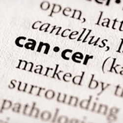 Image of definition of cancer, with the word cancer bolded and the rest of the text faded out to emphasize the word cancer.